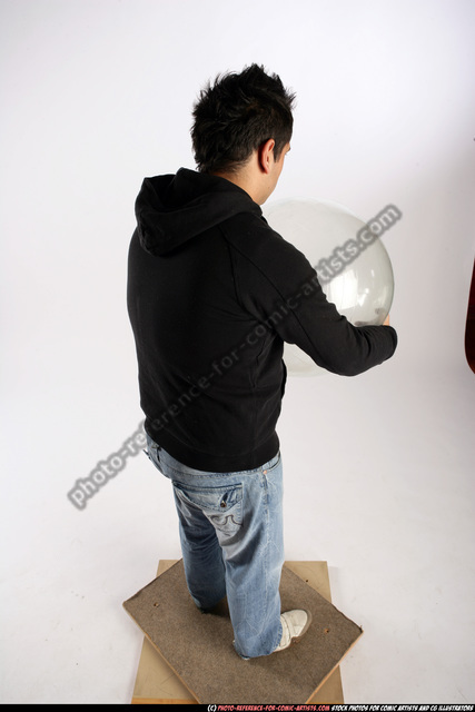 Man Adult Average Black Holding Sitting poses Sportswear