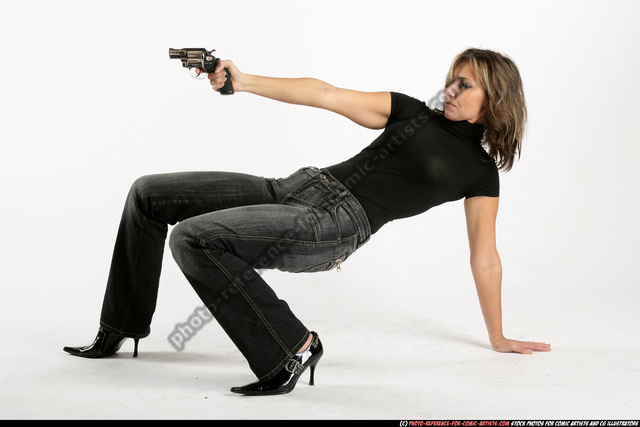 Woman Adult Athletic White Fighting with gun Crouching Casual