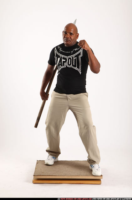 Man Old Average Black Fighting with spear Standing poses Casual