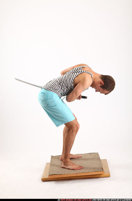 Man Adult Athletic White Fighting with sword Execution Casual