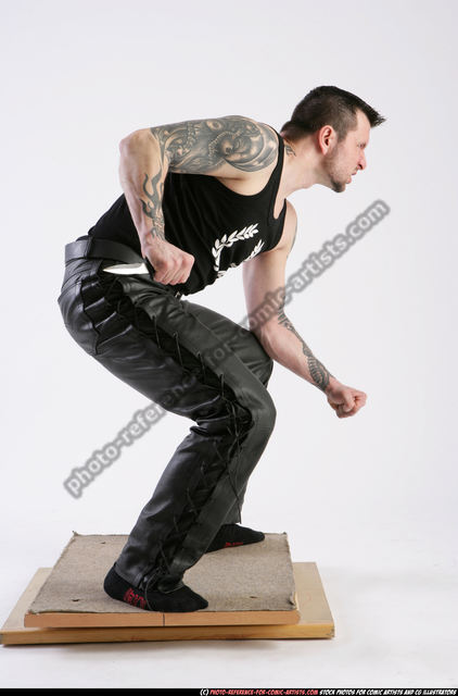 Man Adult Athletic White Fighting with knife Crouching Casual