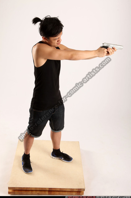 Man Young Athletic Fighting with gun Standing poses Casual Asian