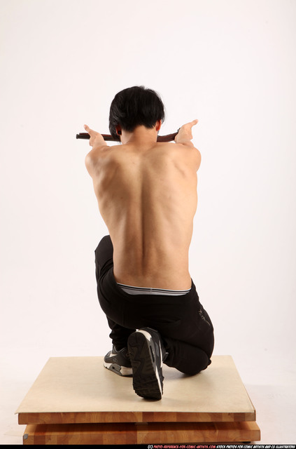 Man Young Athletic Holding Kneeling poses Pants Asian