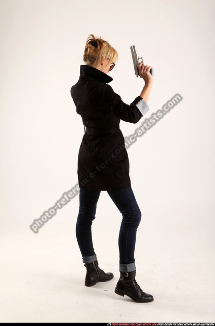 Woman Adult Athletic White Fighting with gun Standing poses Coat