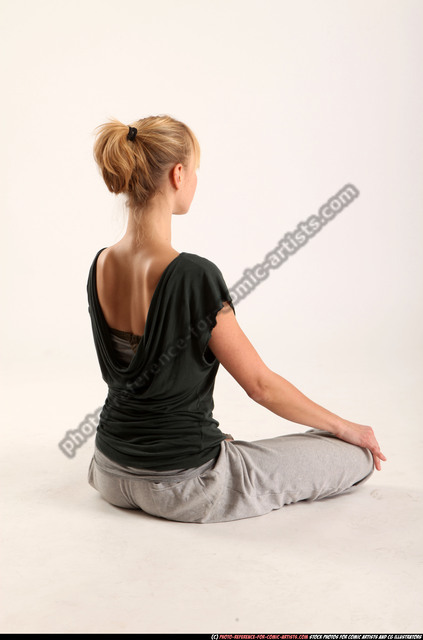 Woman Adult Athletic White Daily activities Sitting poses Sportswear
