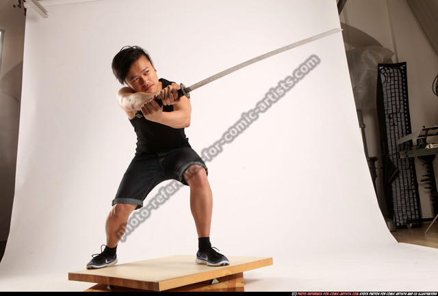 Man Young Athletic Fighting with sword Kneeling poses Sportswear Asian