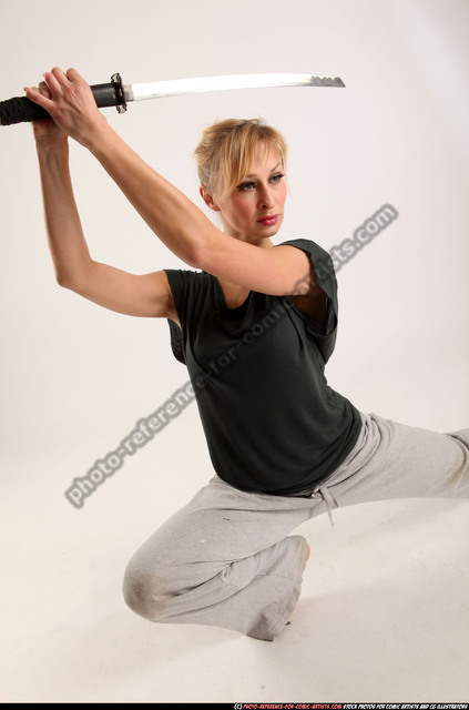 Woman Adult Athletic White Fighting with sword Kneeling poses Sportswear