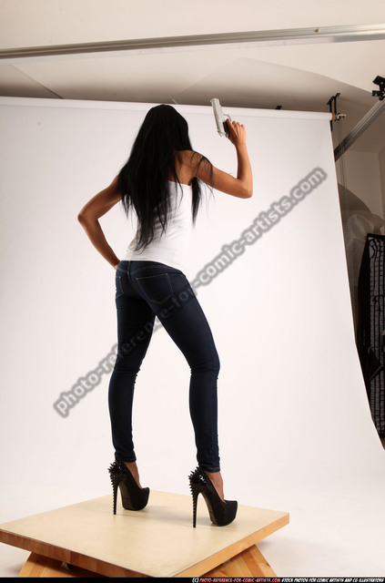 Woman Young Athletic Fighting with gun Standing poses Casual Latino