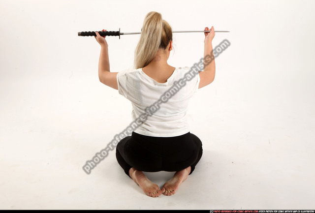 Woman Young Average Fighting with sword Kneeling poses Casual Asian