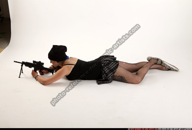 Woman Young Average White Fighting with submachine gun Laying poses Casual