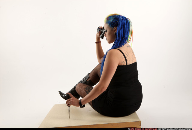 Woman Young Average White Fighting with gun Sitting poses Casual