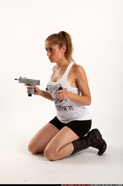 Woman Adult Athletic White Fighting with gun Kneeling poses Casual