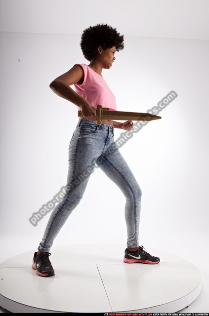 Woman Adult Athletic Black Fighting with sword Standing poses Casual
