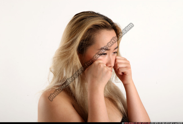 Woman Young Average Facial expressions Decision Casual Asian