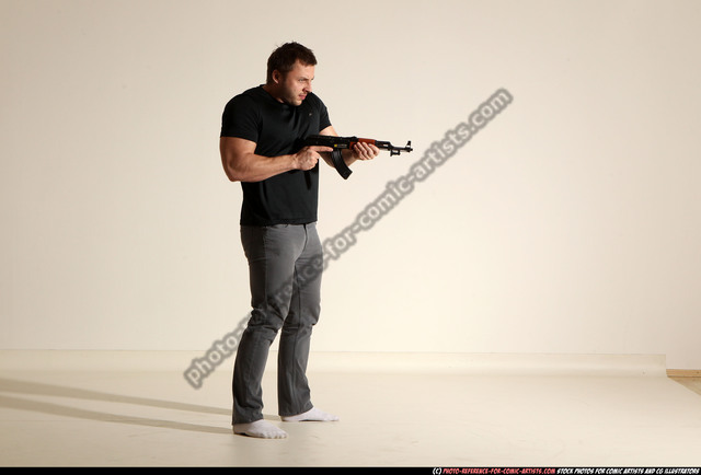 Photo of Man Adult Muscular White Fighting with submachine gun Moving poses Casual