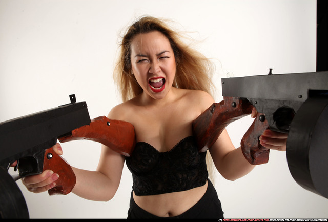 Woman Young Average Fighting with submachine gun Standing poses Asian