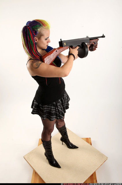 Woman Young Average White Fighting with submachine gun Standing poses Casual