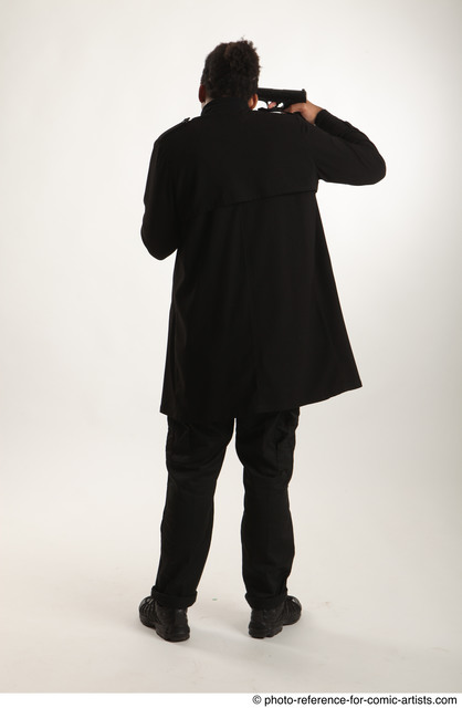 Man Adult Average Black Fighting with gun Standing poses Coat