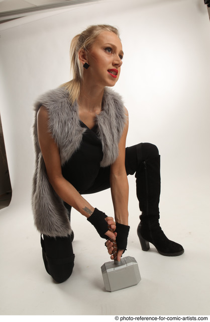 Woman Adult Average White Fighting with hammer Kneeling poses Coat