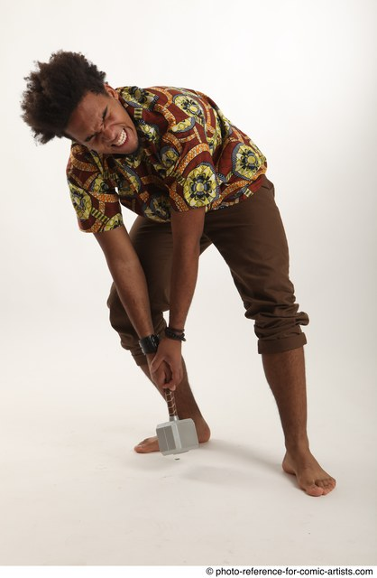 Man Adult Average Black Fighting with hammer Crouching Coat