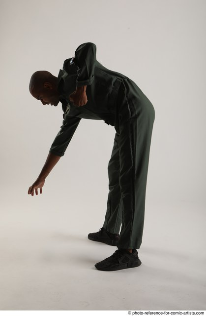 Man Adult Average Black Fighting without gun Standing poses Casual