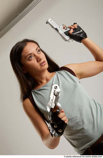 Woman Adult Average Fighting with gun Standing poses Casual Latino