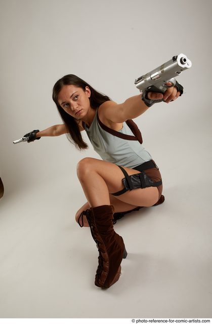 Woman Adult Average Fighting with gun Kneeling poses Casual Latino