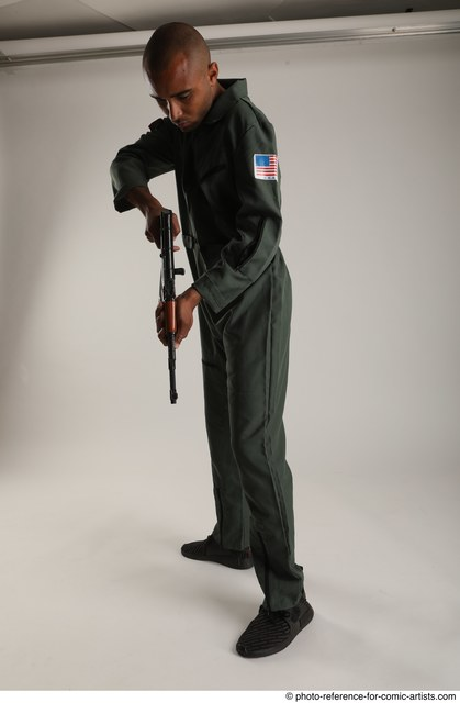 Man Adult Average Black Fighting with gun Standing poses Army