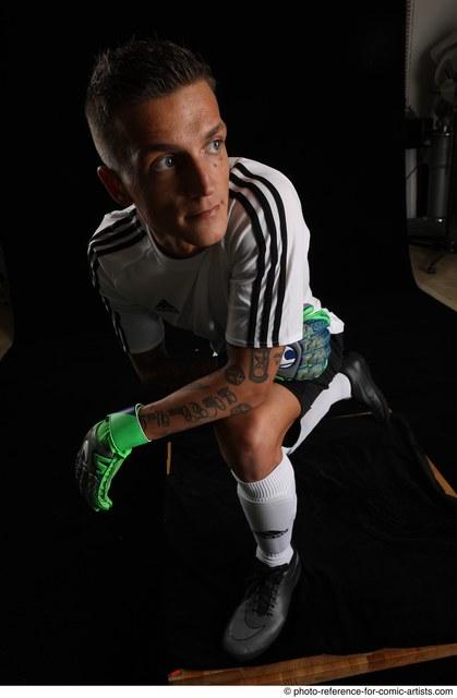 Man Adult Average White Neutral Kneeling poses Sportswear