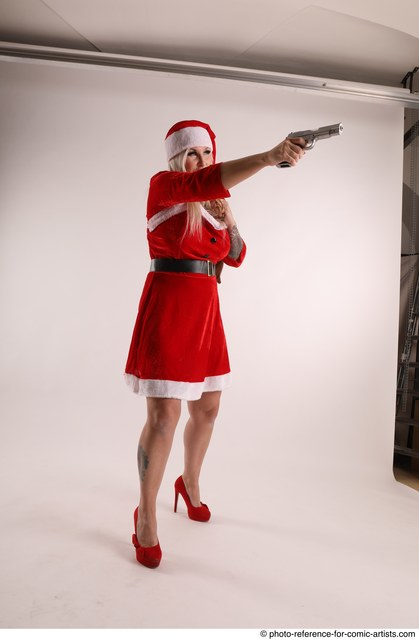 Woman Adult Average White Fighting with gun Standing poses Coat