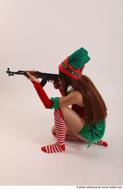 Woman Adult Average White Fighting with gun Kneeling poses Casual