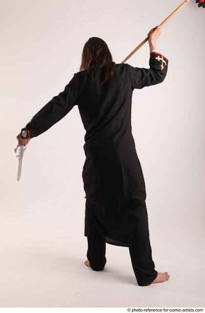 Man Adult Average White Fighting with sword Standing poses Coat