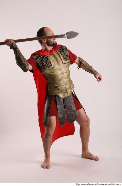 Man Adult Average White Fighting with spear Standing poses Casual