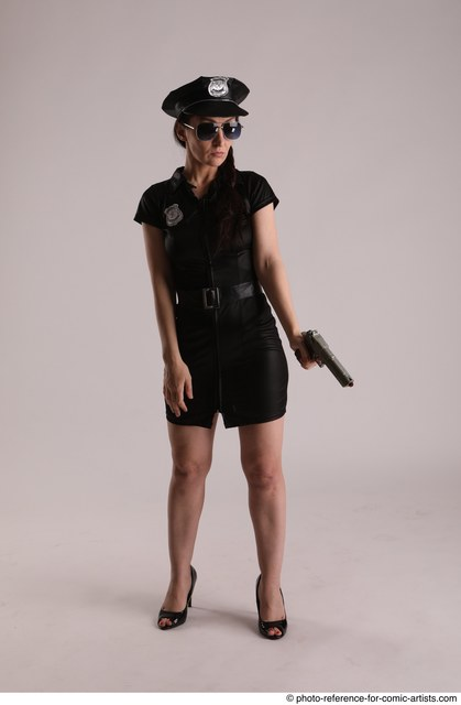 Woman Adult Athletic White Fighting with gun Standing poses Casual