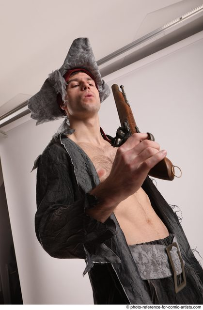 Man Adult Average White Fighting with gun Standing poses Coat