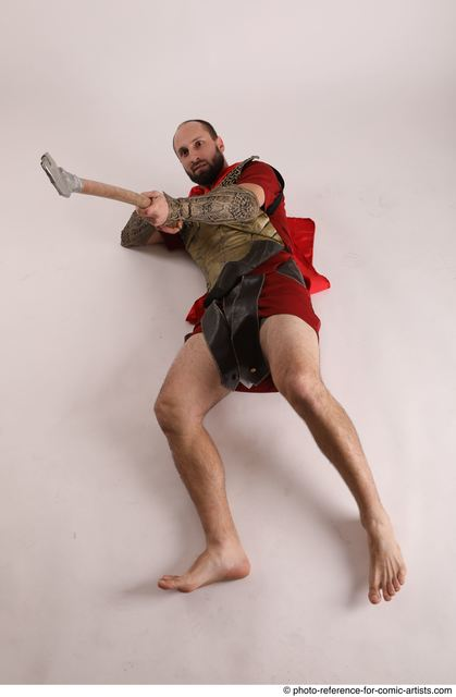 Man Adult Average White Fighting with spear Laying poses Casual