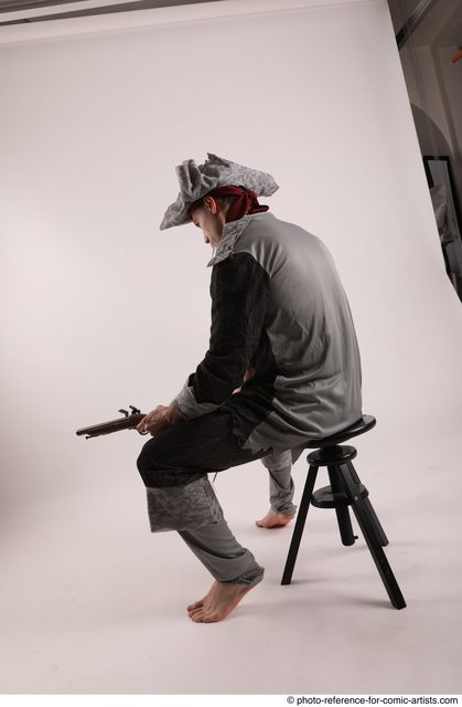 Man Adult Average White Fighting with gun Sitting poses Coat
