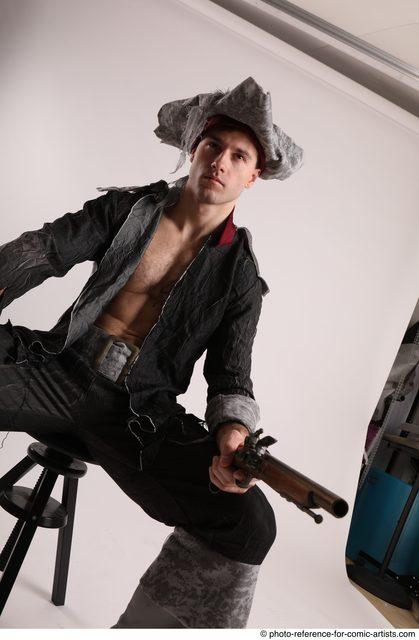 Man Adult Average White Fighting with gun Sitting poses Coat