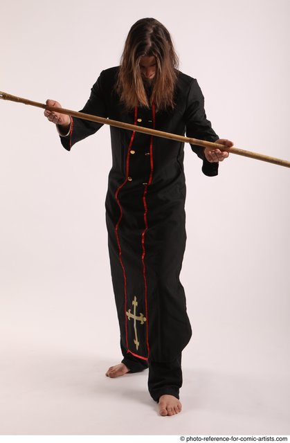 Man Adult Average White Fighting with spear Standing poses Coat