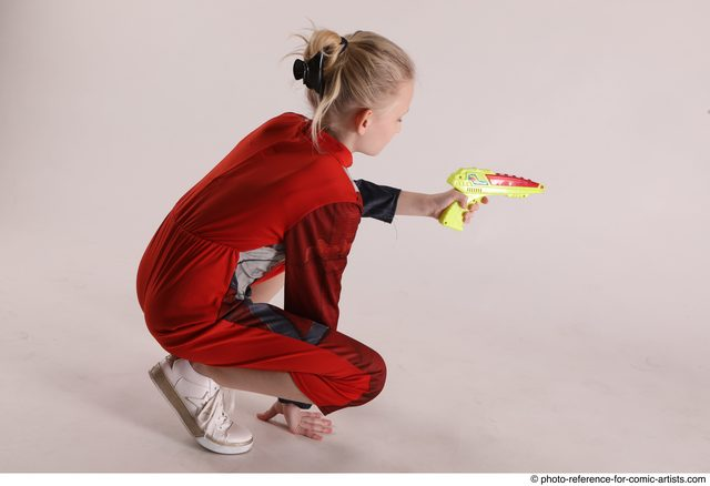 Woman Young Athletic White Fighting with gun Sitting poses Army