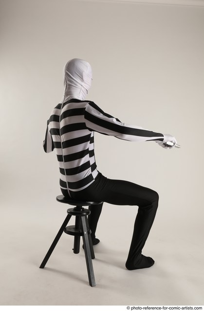 Man Adult Athletic Another Fighting with gun Sitting poses Casual