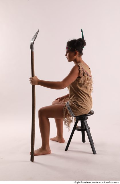 Woman Young Average Black Fighting with spear Sitting poses Casual