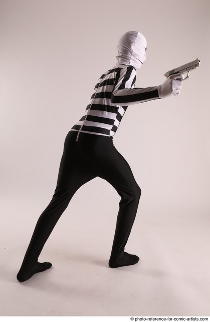 Man Adult Athletic Another Fighting with gun Standing poses Coat