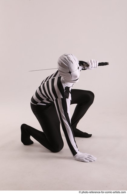 Man Adult Athletic Another Fighting with sword Kneeling poses Casual