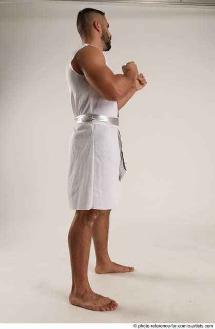 Man Adult Muscular Fist fight Standing poses Coat Latino