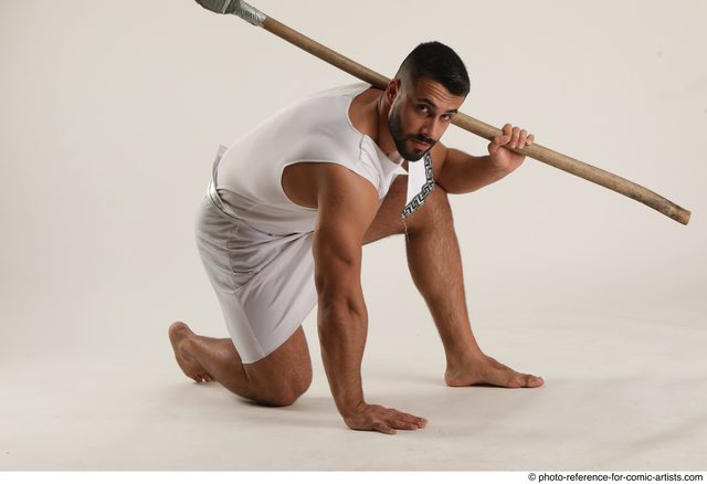 Man Adult Muscular Fighting with spear Kneeling poses Coat Latino