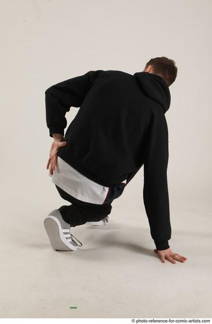Man Adult Athletic White Kneeling poses Sportswear Dance
