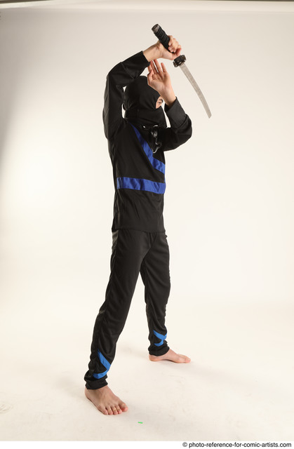 Man Young Athletic Fighting with sword Standing poses Casual Asian