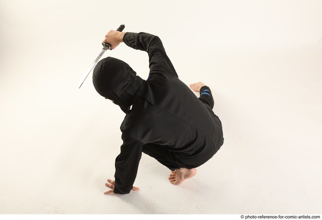 Man Young Athletic Fighting with knife Kneeling poses Casual Asian