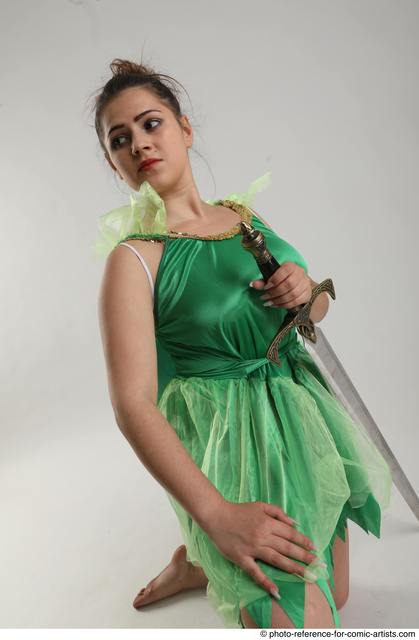 Woman Adult Average White Fighting with sword Kneeling poses Casual